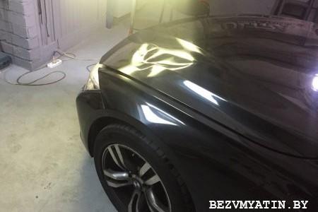 BMW F10 — вмятина на капоте