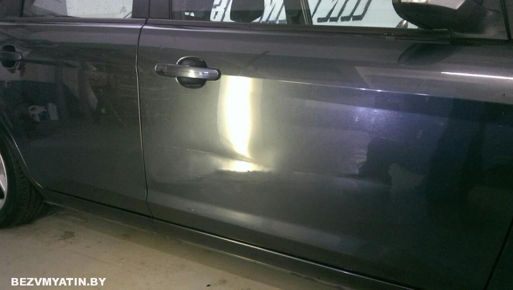 форд - повреждение на двери до ремонта