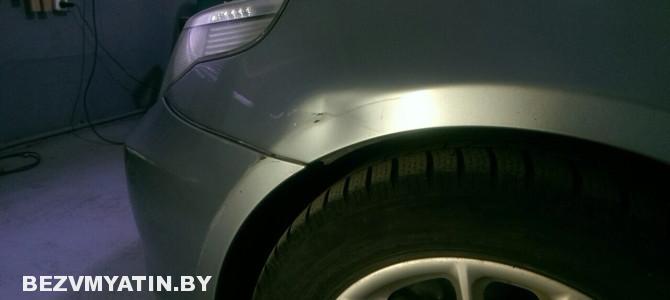 BMW — вмятина на переднем крыле на арке