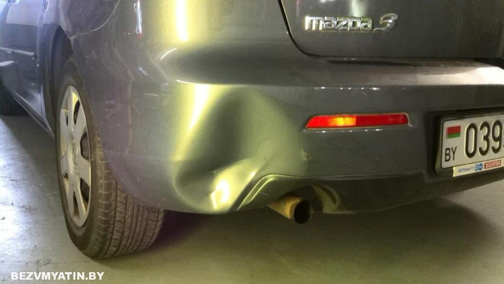 Mazda 3 - вмятина на заднем бампере до ремонта