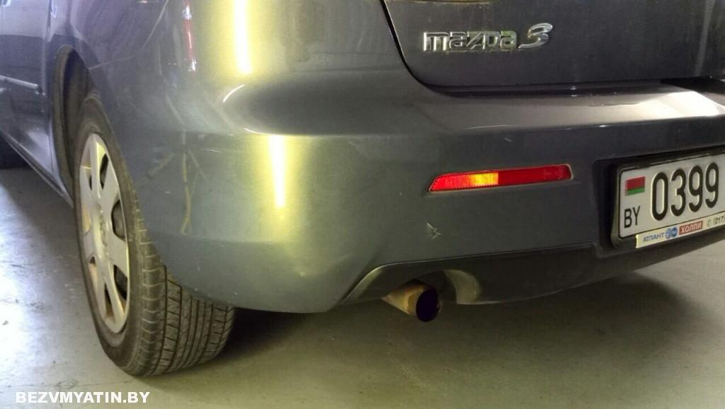 Mazda 3 - вмятина на заднем бампере после ремонта