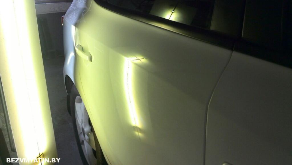Kia Ceed - вмятина на задней правой двери после выправления