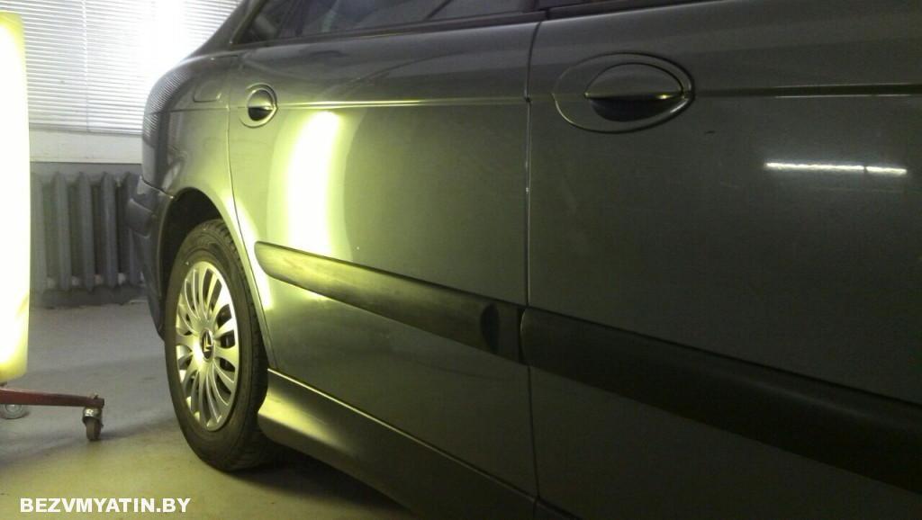 Citroen C5 - вмятина на задней правой двери после ремонта