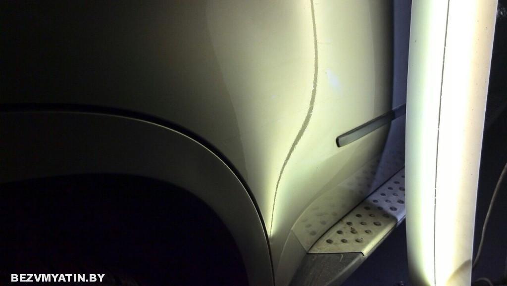 Bmw X5 - вмятина на задней правой двери после выправления