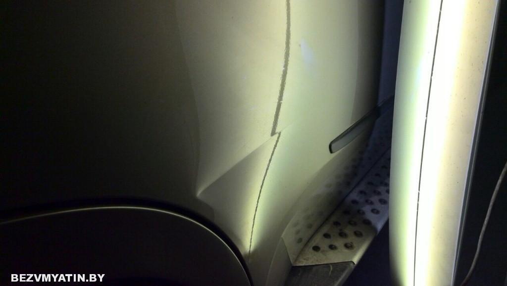 Bmw X5 - вмятина на задней правой двери до выправления