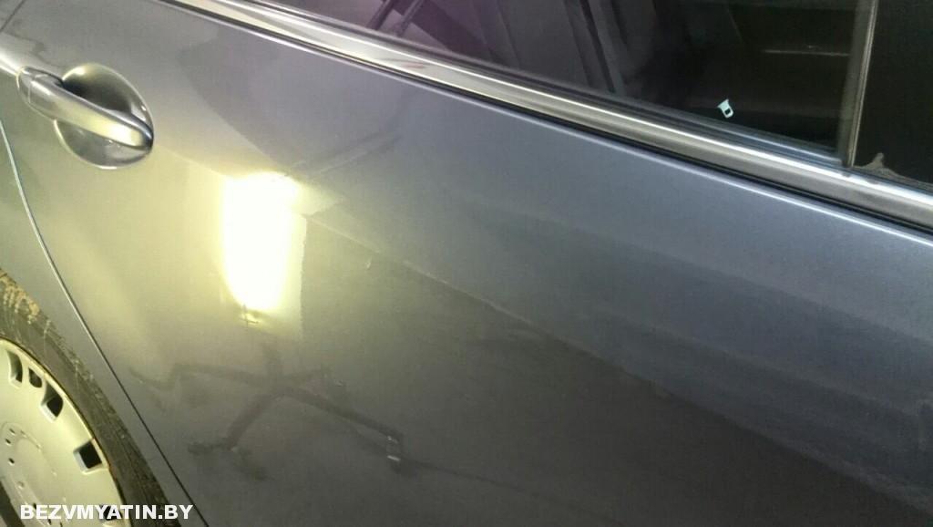 Mazda 6 - вмятина на задней правой двери после выправления