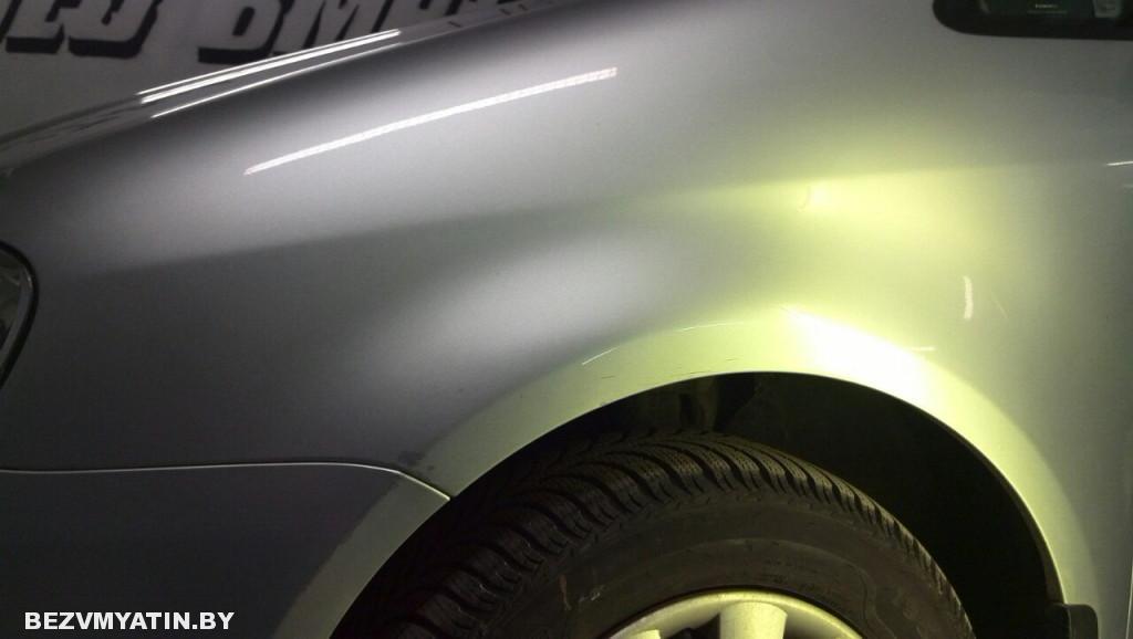 Volkswagen Touran - вмятина на переднем левом крыле после выправления