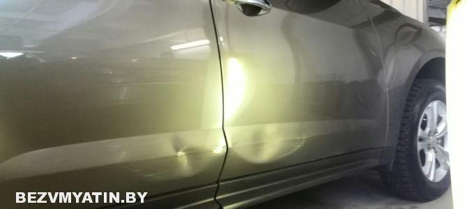 Chevrolet Equinox — вмятины на передней и задней правых дверях
