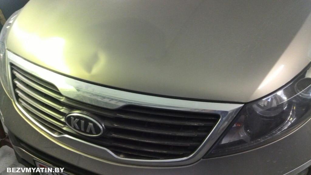 Kia Sportage - вмятина на капоте до ремонта