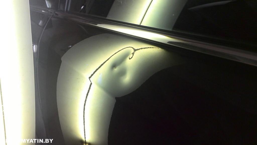 Nissan Sentra - вмятина на задней левой двери до ремонта