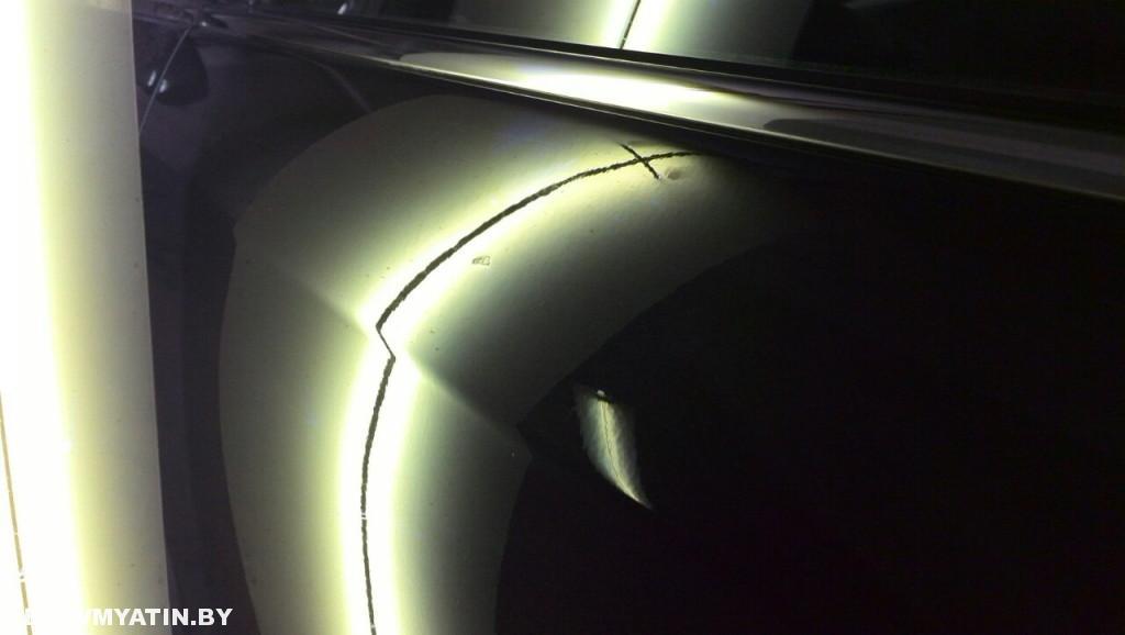 Nissan Sentra - вмятина на задней левой двери после ремонта