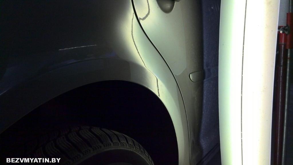 Volkswagen Touran - вмятина на задней правой арке после ремонта