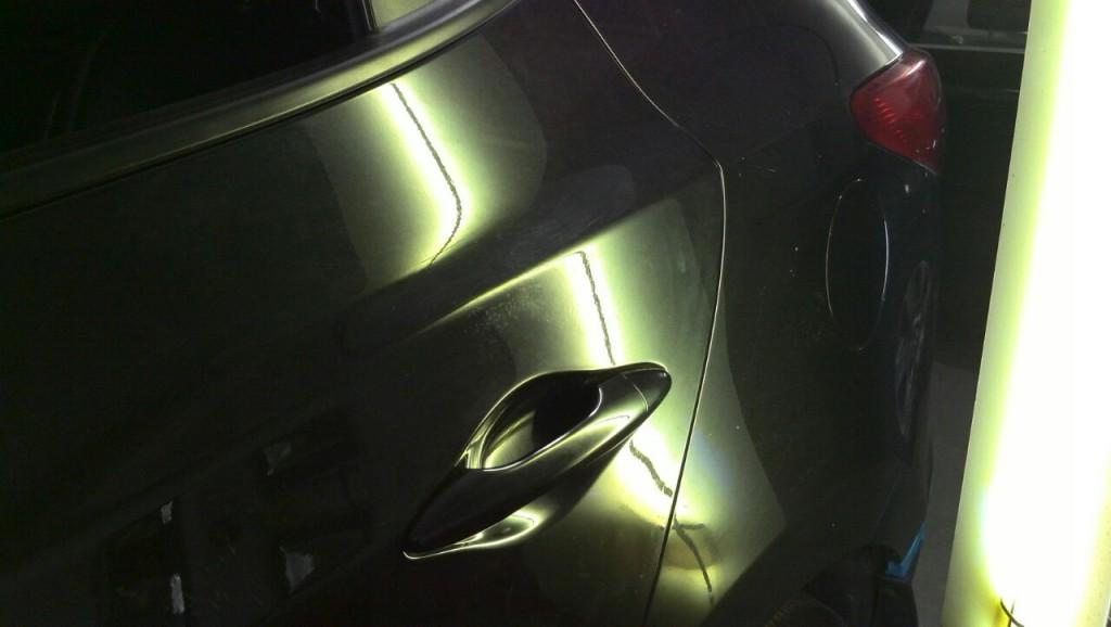 Hyundai ix35 - вмятина на задней левой двери после удаления