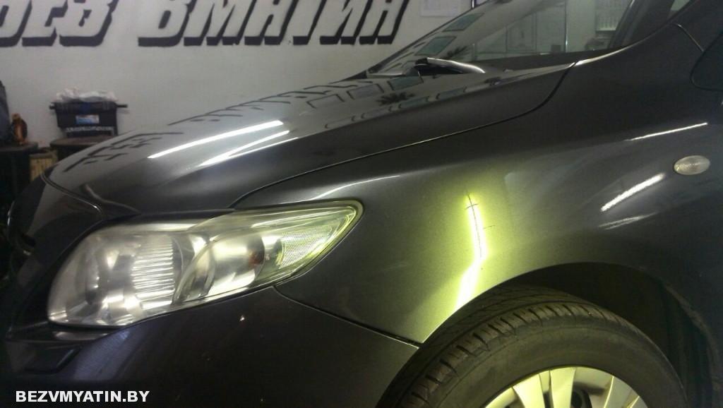Toyota Corolla - вмятина на переднем левом крыле после выравнивания