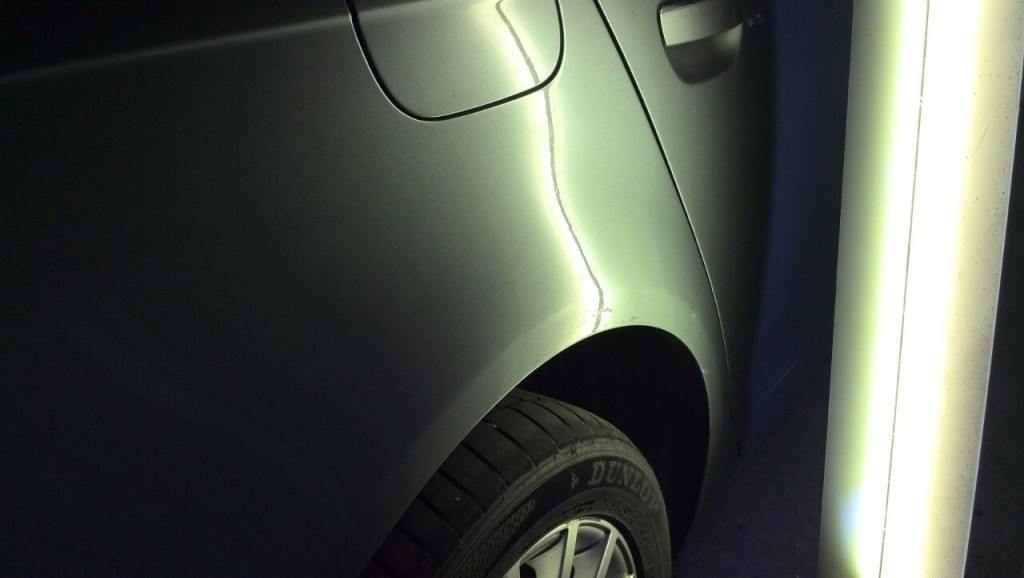 Audi A6 - вмятина на заднем правом крыле после ремонта