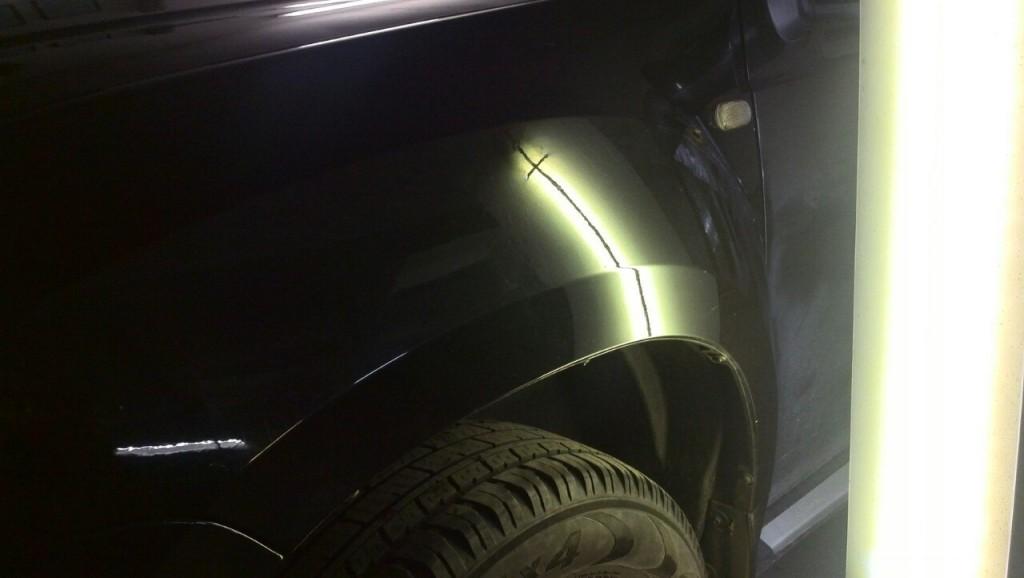 Renault Duster - вмятина на переднем левом крыле после ремонта