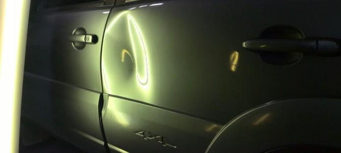 Chevrolet Niva — вмятина на задней левой двери