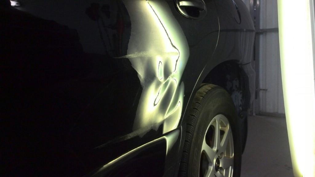 Hyundai Tucson - вмятина на задней левой двери до ремонта
