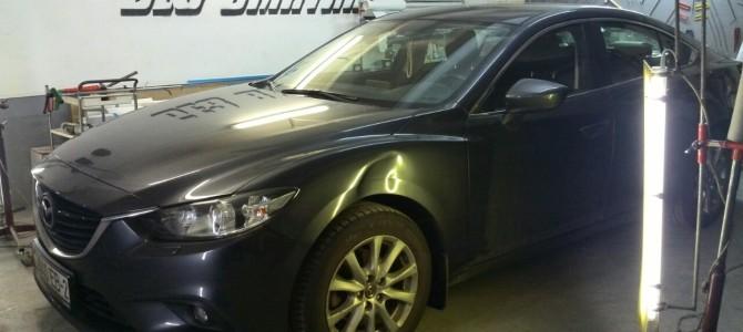 Mazda 6 — вмятина на переднем левом крыле.