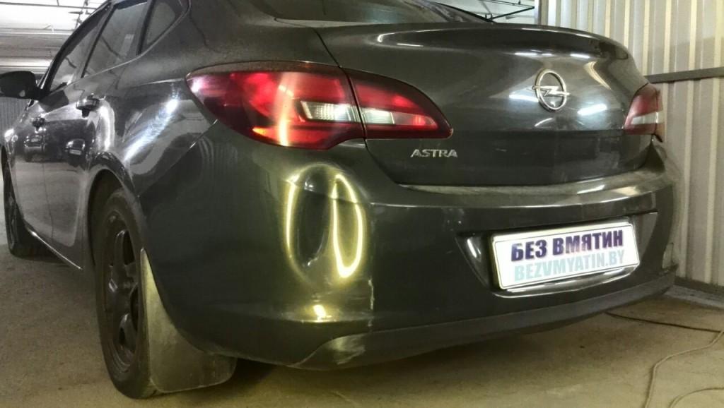 Opel Astra - вмятина на заднем бампере до ремонта