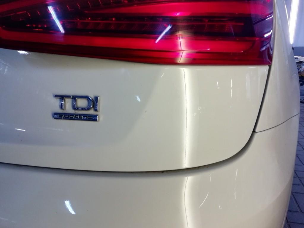 AUDI Q3 - вмятина на крышке багажника после удаления