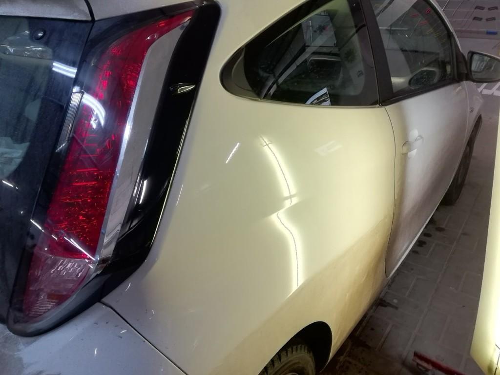 Toyota Aygo - вмятина на заднем крыле после ремонта