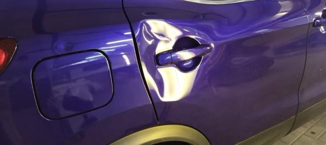 Nissan Qashqai — Вмятина на задней двери.