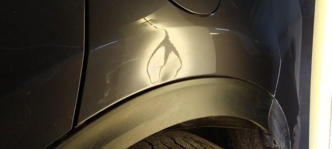 Hyundai Tucson-Вмятина на заднем крыле.