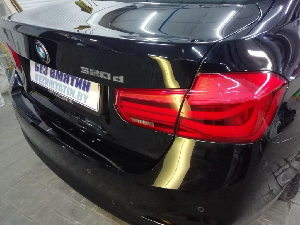 BMW - вмятина на крышке багажника после ремонта
